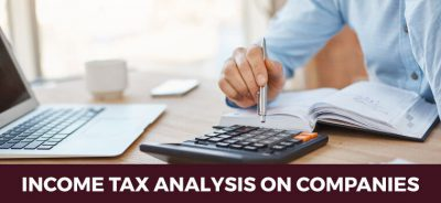income-tax-analysis-on-companies ,pen ,calculator, counting
